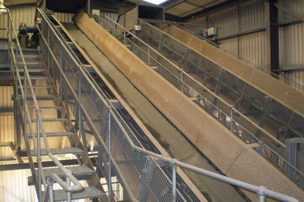 One of the hopper feed conveyors